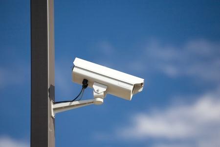 surveillance camera on light pole in parking lot