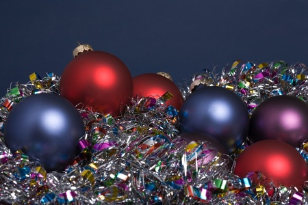 Holiday tree ornaments on tinsel garland photo