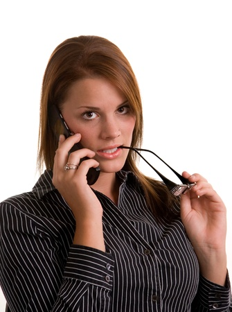 A young woman answering a personal call on her cell phone Stock Photo - 8931574