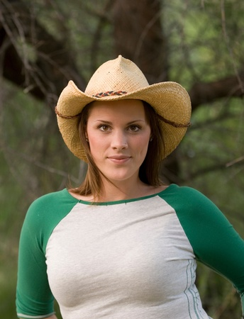 A young woman in cowboy hat photo