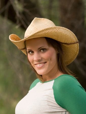 Smiling young lady in cowboy hat photo