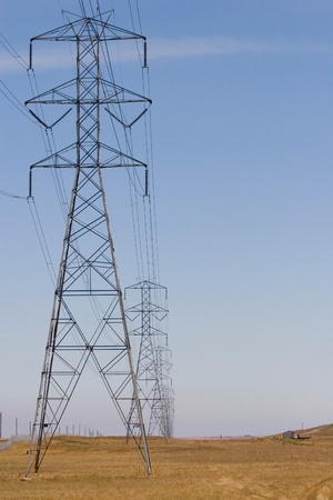 High voltage electic pylons and power lines photo