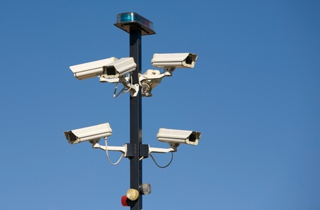 private security: Cluster of security cameras at entrance to secure area.