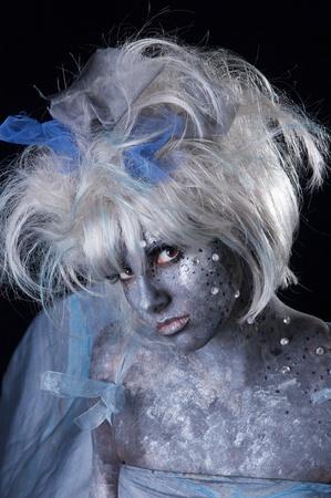 A dark and surreal fairie creature.