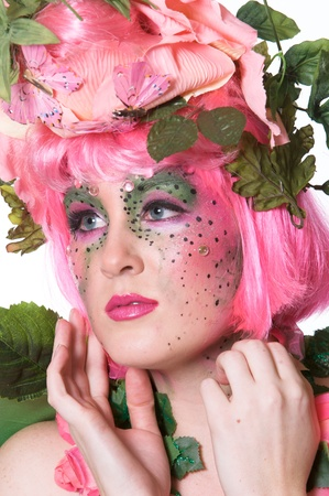 stage makeup: Giovane donna con il trucco di scena come una fata primavera o in estate Archivio Fotografico