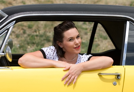 Pinup model and retro car photo