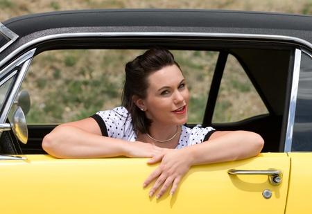retro woman: Pinup model and retro car Stock Photo