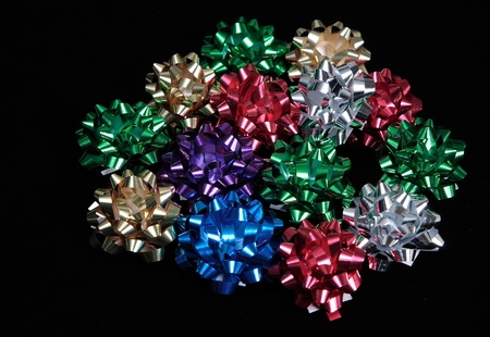 Assortment of brightly colored holiday bows photo