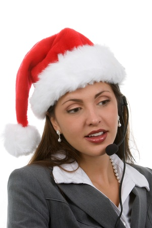 Young woman in santa hat and phone headpiece doing holiday sales calls Standard-Bild