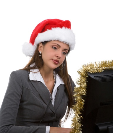 Young woman in santa hat and phone headpiece doing holiday sales calls Stock Photo