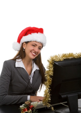 Young woman in santa hat and phone headpiece doing holiday sales calls photo