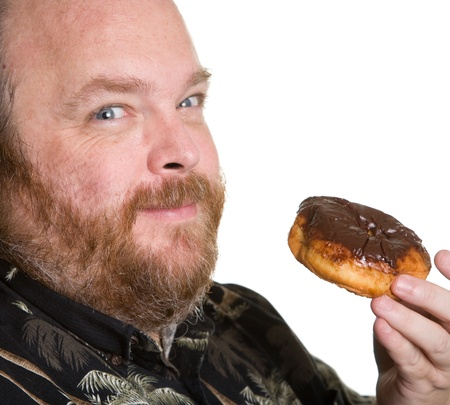 doughnut: Middle aged and obese man about to eat a chocolate donut