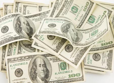 Abstract Pile of 100 dollar bills. photo