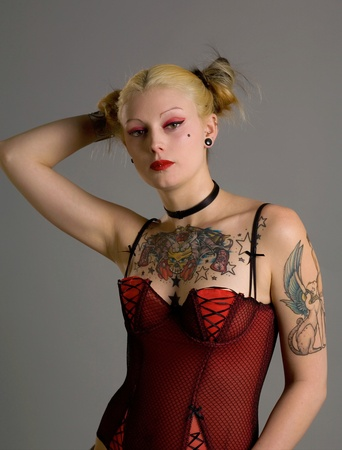 A young goth girl with tattoos and piercings photo