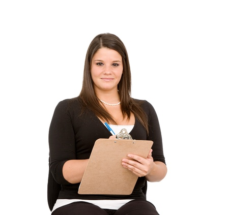 taking inventory: Pretty young woman with clipboard on white background.  Taking inventory, checking checklist.