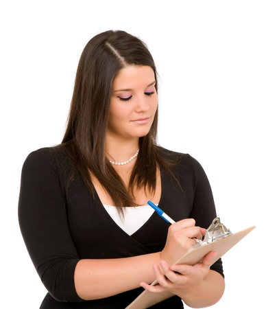 Pretty young woman with clipboard on white background.  Taking inventory, checking checklist.