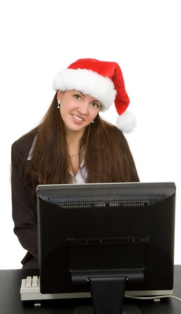 Young woman on computer for doing support for christmas sales photo