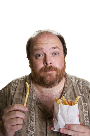 Overweight man in mid forties eating fast food photo