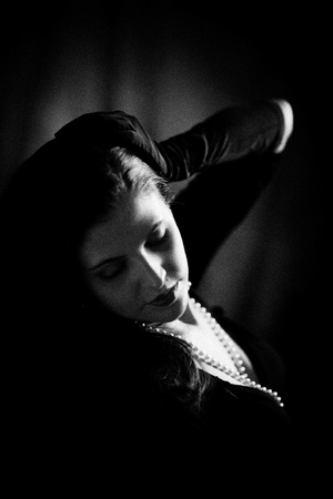 Image of woman shot with dramatic lighting.  Processed with NIK SIlverEFX for authentic b&w film grain.