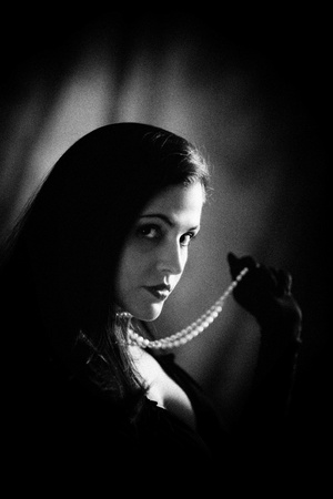 Image of woman shot with dramatic lighting.  Processed with NIK SIlverEFX for authentic b&w film grain. photo