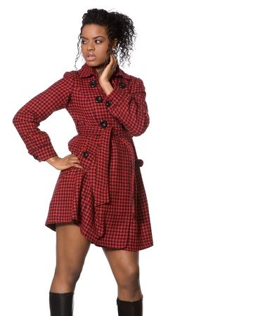 african fashion: Young african american fashion model in red coat on white background.