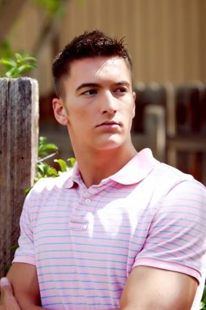 Young casual man posing outdoors