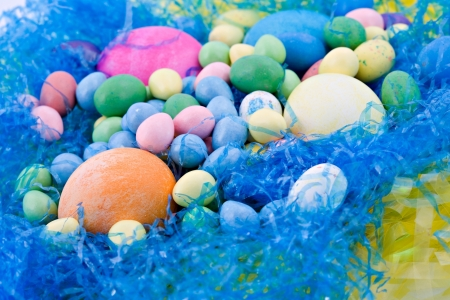 Easter candy and eggs with bright spring colors Stok Fotoğraf