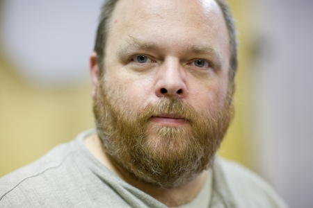 mid adult men: Portrait of a middle aged and obese bearded man  Stock Photo