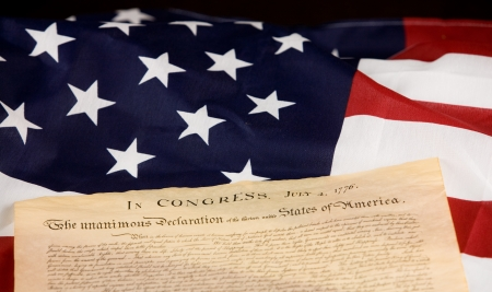Declaration of Independance against an American flag. photo