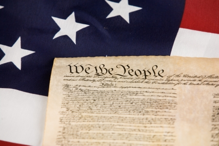 US Constitution against an american flag. photo