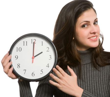 daylight savings time: Woman setting clock at daylight savings time.