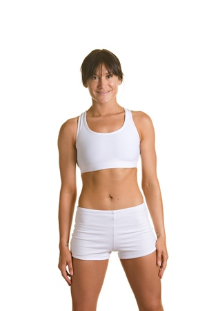 Fitness model in white workout suit against white background. Imagens