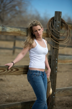 Young cute country girl outdoors on the farm in Colorado