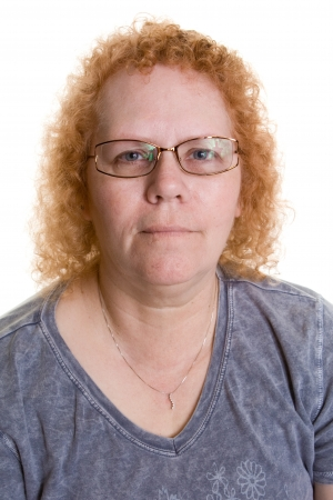 Close up of a heavy set middle aged woman with glasses Standard-Bild