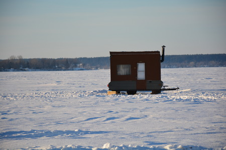 shack: Fishing shack on frozen lack Stock Photo
