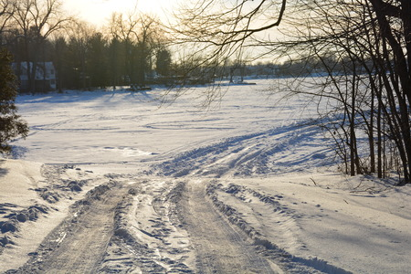 A winter lake ice  road leads to adventure.