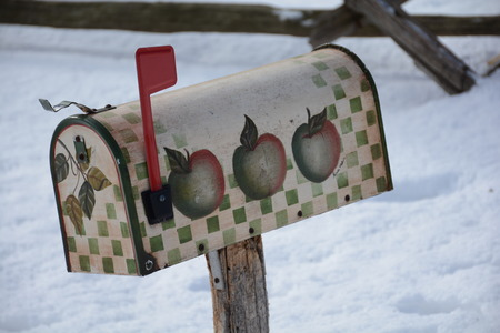 quaint: Quaint postal box with red flag indicating malil received.