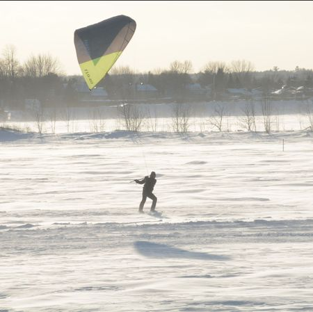 Parasailing on a northern lake in winter