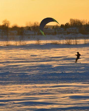 Parasailing on a frozen northern lake Reklamní fotografie
