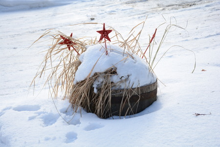 Winter Christmas decorations left in the snow Reklamní fotografie