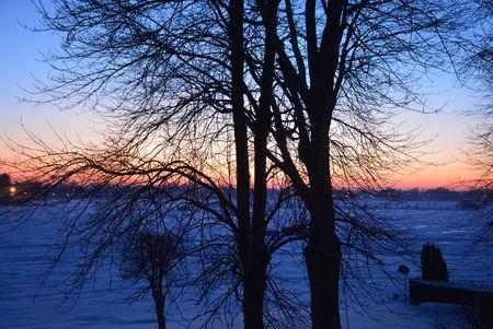 Winter sunset over a northern lake Reklamní fotografie