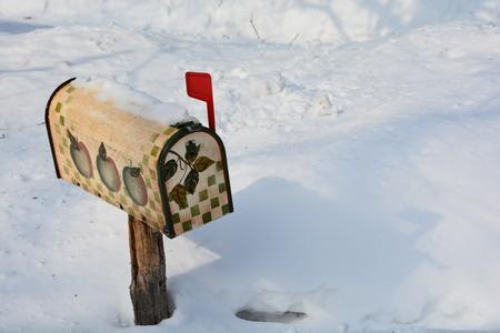 indicates: A quaint mailbox indicates mail inside