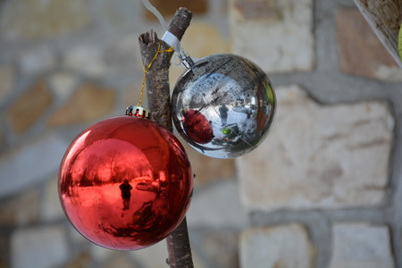 Two exterior Christmas decorations reflecting the photographer