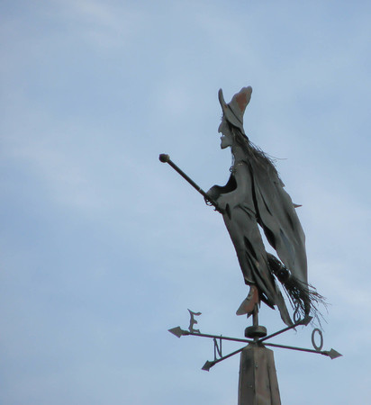 A Halloween  witch mounted on a rooftop soars over Canada
