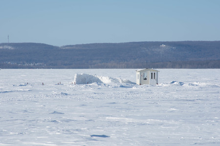 Ice-fishing hut on a frozen lake