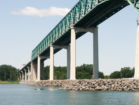 A railroad bridge spans the Saint Lawrence River in Quebec