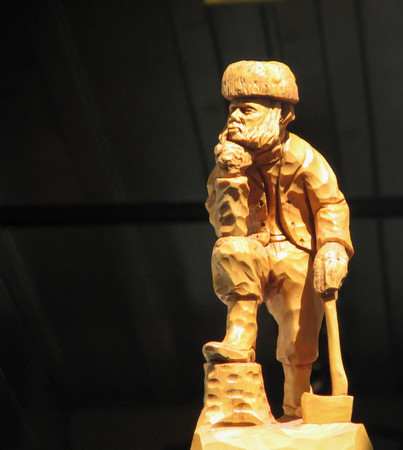 A Quebec logger is sculpted in wood