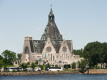 pull along: Tourist buses pull up to this picturesque rural church along the St. Lawrence River