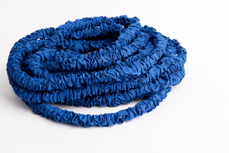 The hose of a garden hose of blue color, made of modern materials, can grow in size, stretchable
