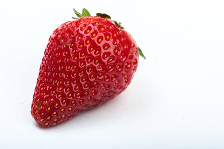 ripe strawberries on a white background